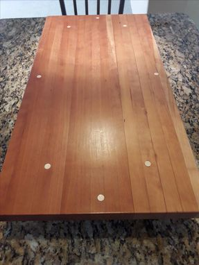 Custom Made Cherry Cutting Board With Five Inch Legs And Maple Inlay