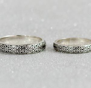 Custom wedding rings design your own wedding bands custommade davids wedding bands black finish gives the detailed norse design a visual pop in this matching band set and her ring sparkles with channels of moissanite junglespirit Images