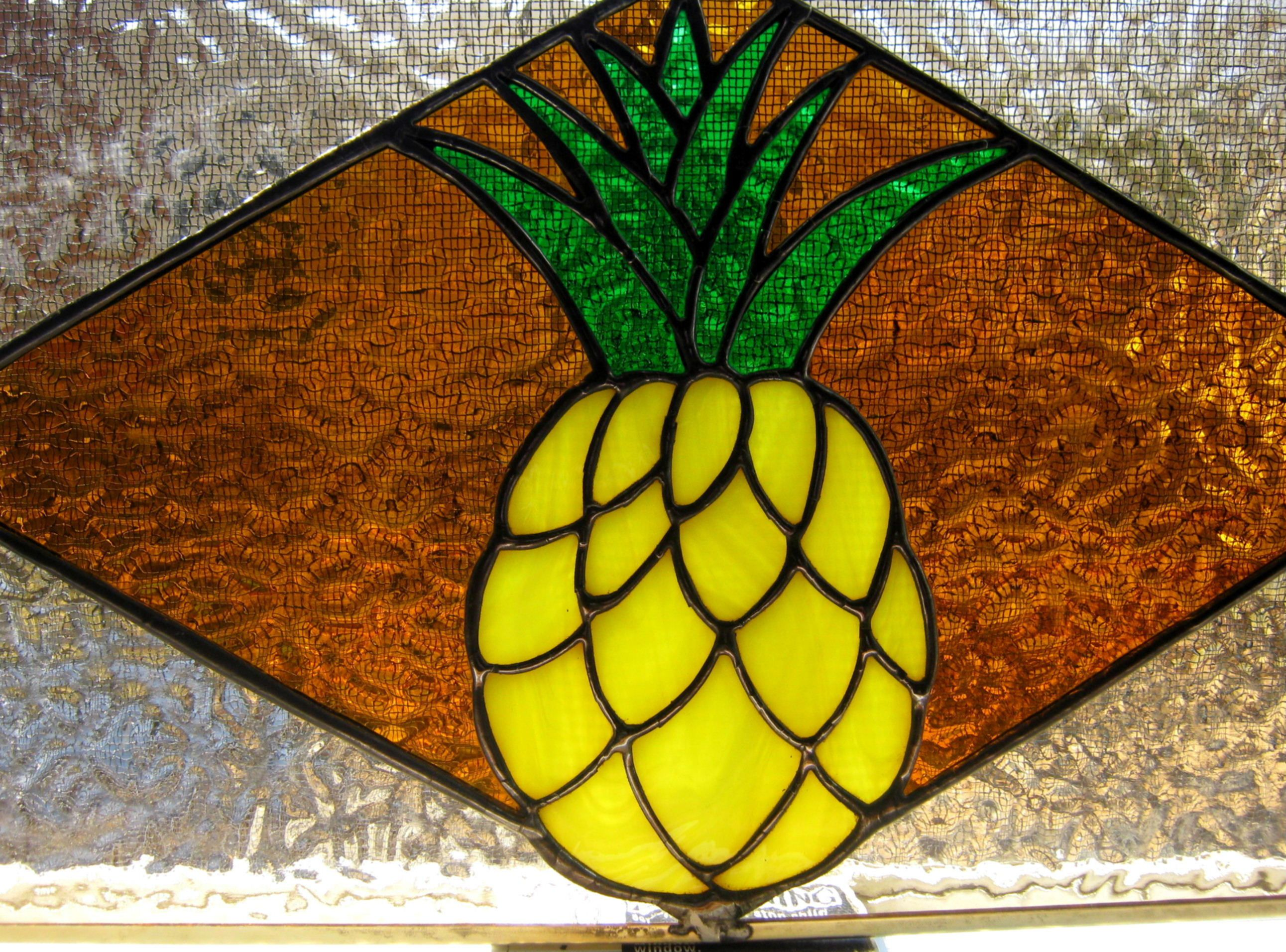 Custom made stained glass pineapple transom window by for Custom transom windows