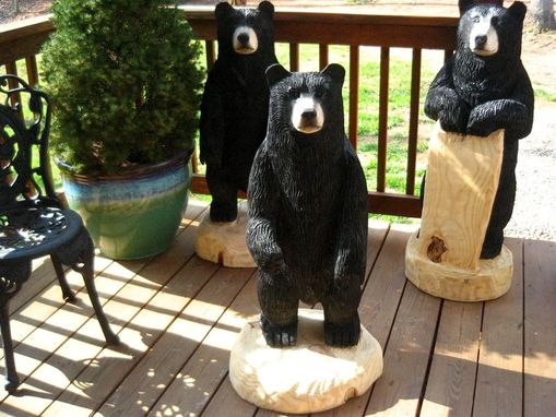 Custom Made Black Bear Holding A Sign Chainsaw Wood Sculpture