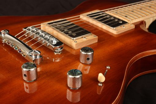 Custom Made Mahogany And Maple Carved Top Guitar