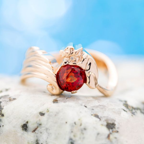 We sourced this unique orange-red ruby is the perfect centerstone for this pokemon-fan's vulpix engagement ring and its orange mane.