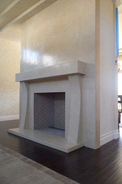 10 piece concrete fireplace surround. Made of high performance glass fiber reinforced concrete. End caps are one piece and 10