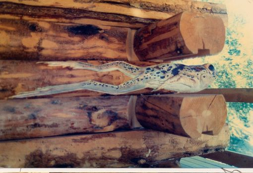 Custom Made Carvings On A Log Cabin In California Mountains