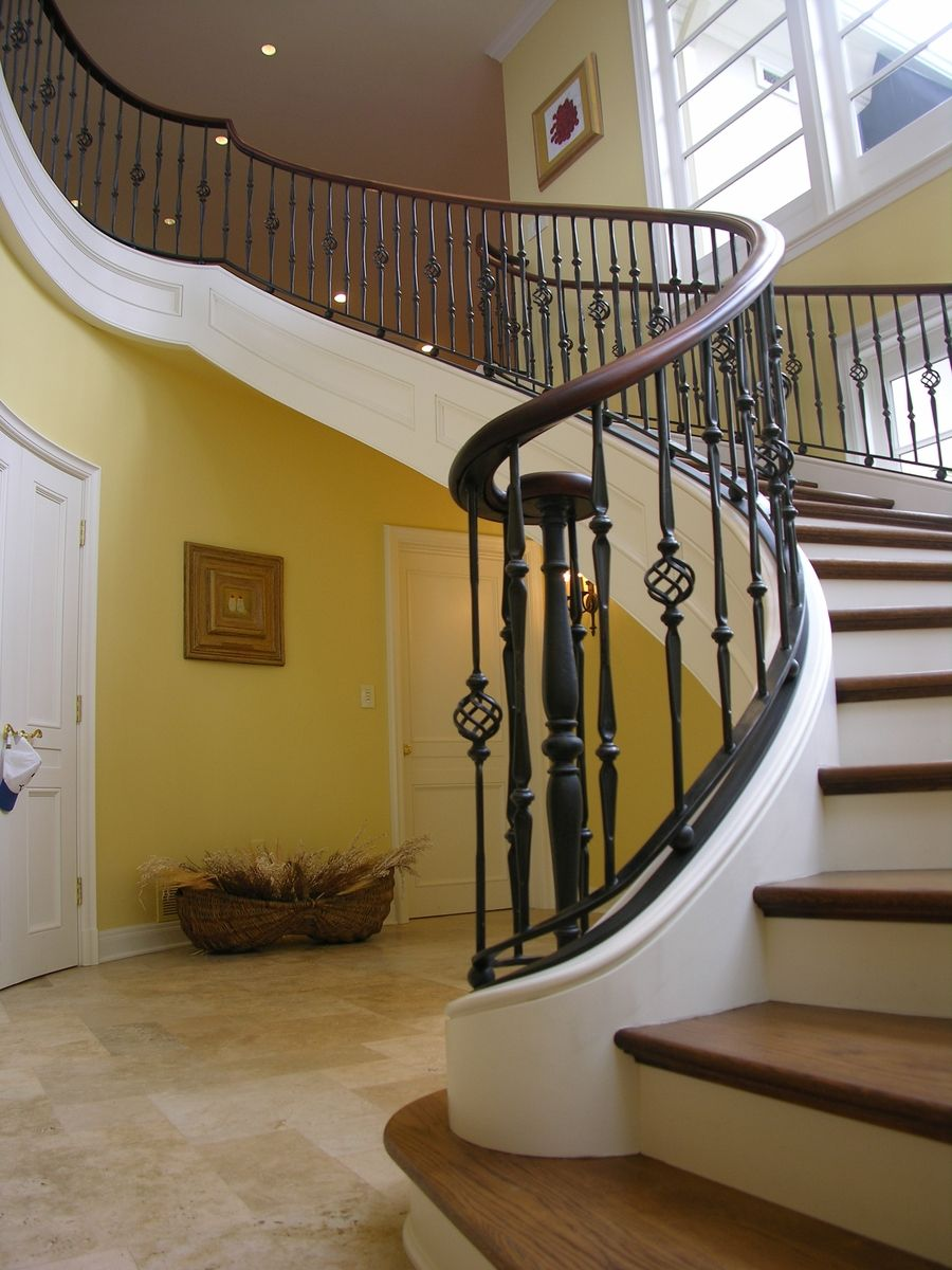 Custom curved free standing stair by master woodworks inc for Arched staircase