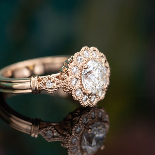 Vintage-inspired rose gold and diamond ring, with scalloped halo and milgrain accents.