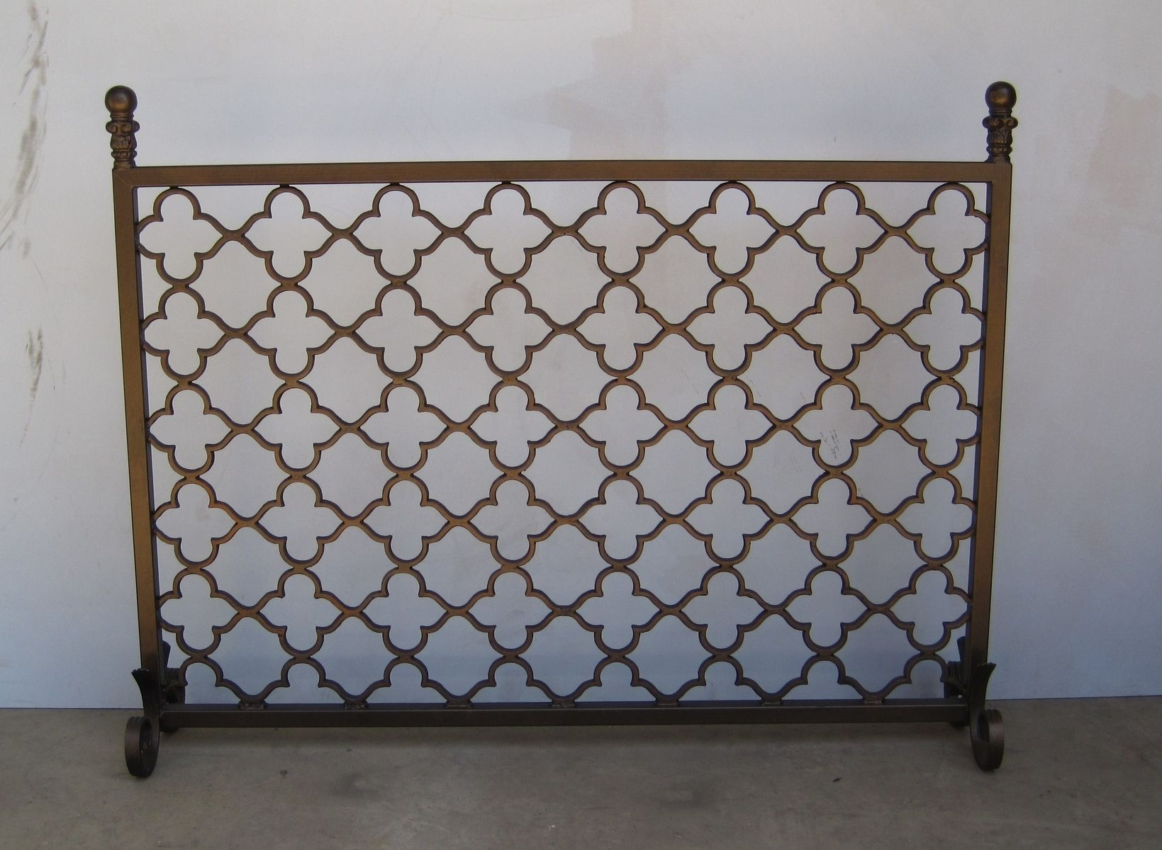 Hand forged metal fireplace screen. Freestanding and custom made to fit.…