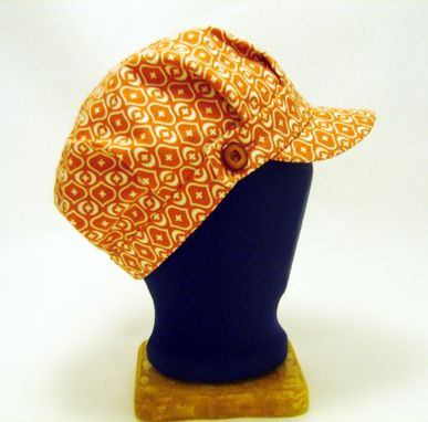 Custom Made Orange Engineer Cap With Buttoned Band And Geometric Print