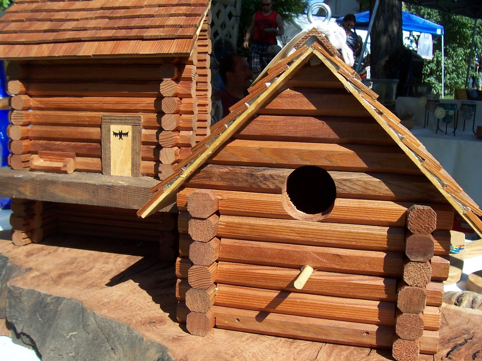 hand crafted bird and bat log cabin houses by wolf creek woodworks