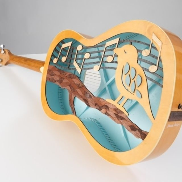 custom laser cutting acoustic guitar for charity project by