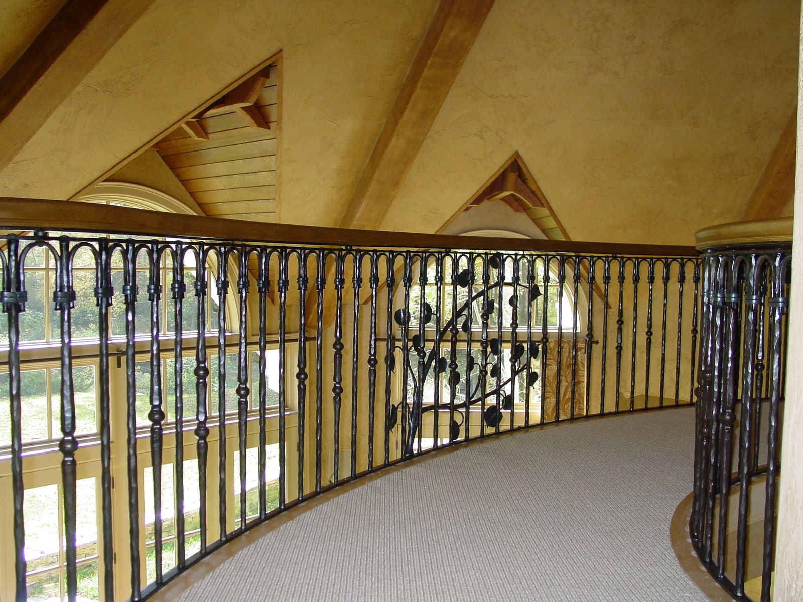Custom made wrought iron stair and bridge railing by
