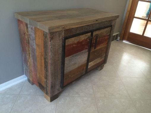 Custom Made Reclaimed Barnwood Cabinetry With Steel Framed Doors.