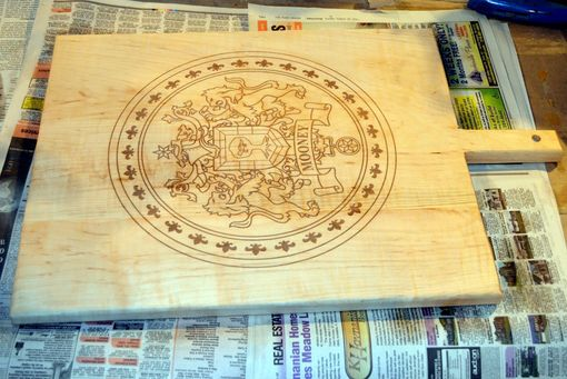 Custom Made Cutting Board With A Family Crest Engraved Into It
