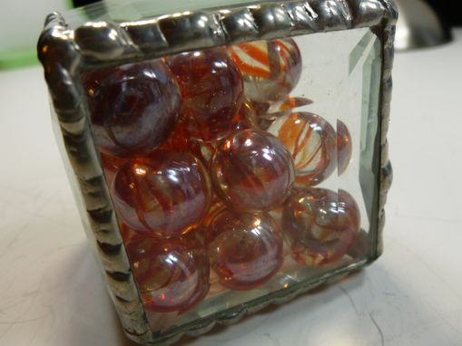 Custom Made Cubic Glass Paperweight With Orange-Colored Glass Marbles