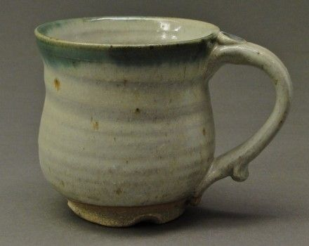 Custom Made Handmade Stoneware Pottery Mug With Wood Ash Glaze And A Copper Green Stained Rim, (Sku 22)