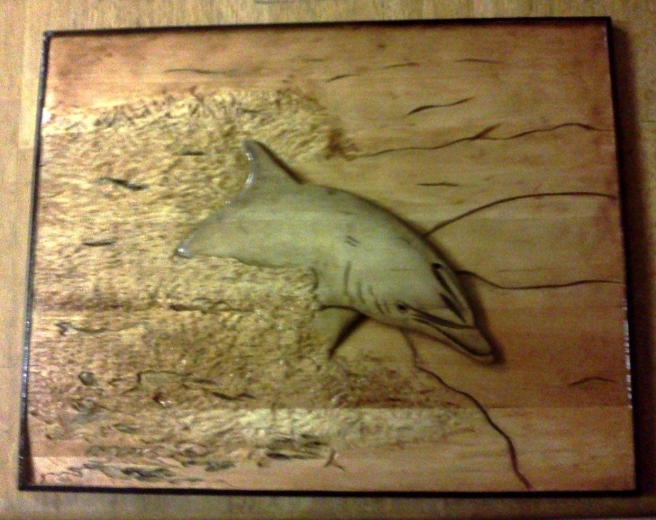 Custom dolphin relief carving by carvings mark
