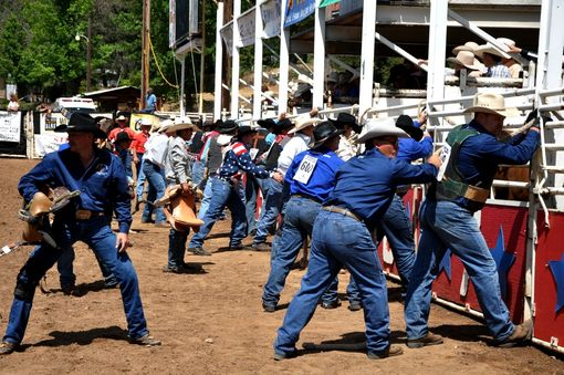 Custom Made Fine Art Photograph Of Cowboys Opening The Bucking Shoots