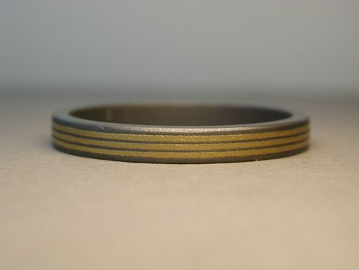 Custom Made Wedding Ring In Titanium And Pure Gold