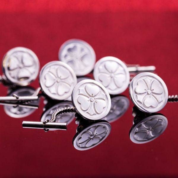 A set of 6 tie tack pins designed with an element of the family crest.