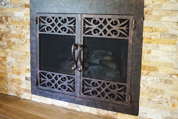 Custom wrought iron fireplace doors by fireplace door guy for Custom wrought iron fireplace screens