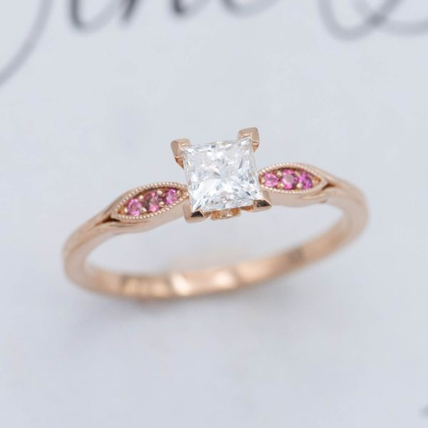 Delicate rose gold ring with princess cut diamond and pink tourmaline accents.