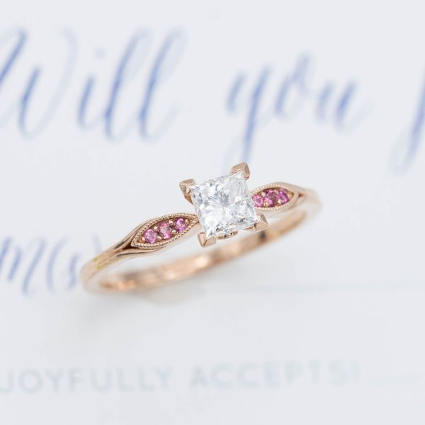 Delicate rose gold setting for an 0.8ct princess cut diamond with romantic pink tourmaline accents.