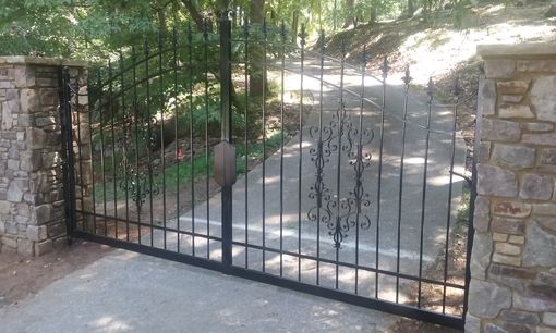 Custom Made Affordable Iron Gates With Flair
