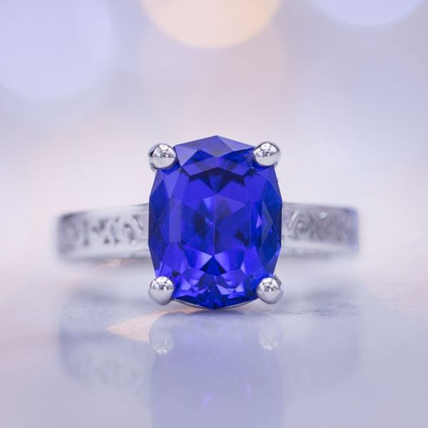 A violet-tinged rich blue color is the ideal shade for tanzanite, perfectly showcased in this stunning ring.