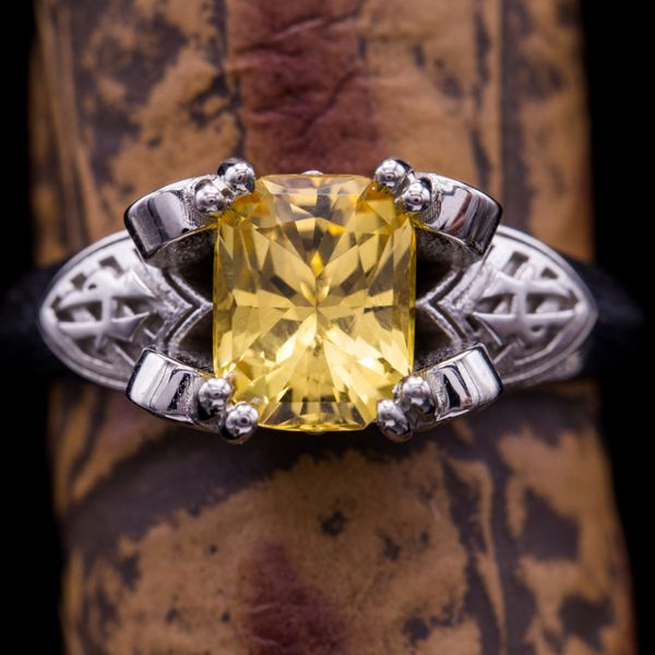 Imperial topaz ranges from yellow to peach-orange and pink, and is the most valued color range of topaz. Here, we found a radiant cut stone in a more purely yellow shade to match this Harry Potter fan's themed Hufflepuff engagement ring.