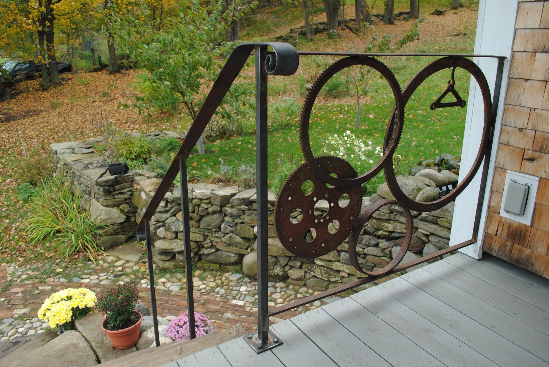 Handmade Forged Iron Wagon Gear Wheel Railing By Mystic