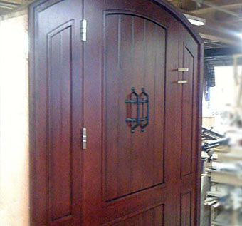 Custom Made Custom Paneled Arched Entry Door