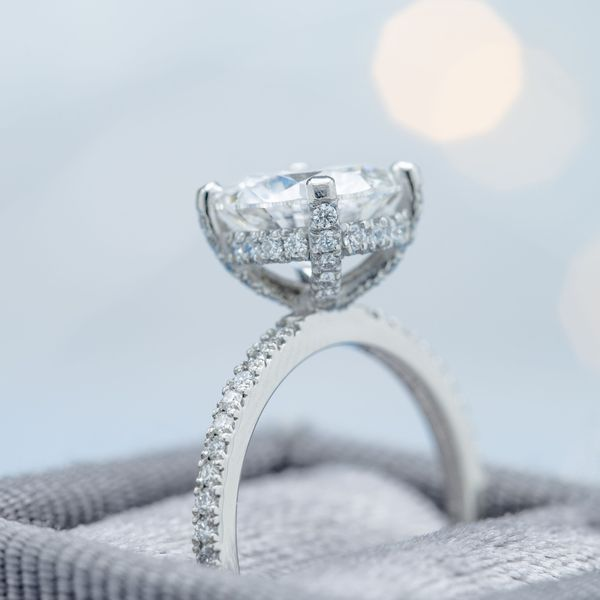 The gallery rail holding up this ring's diamond center stone is lined with diamonds to create a look much like a falling edge halo.