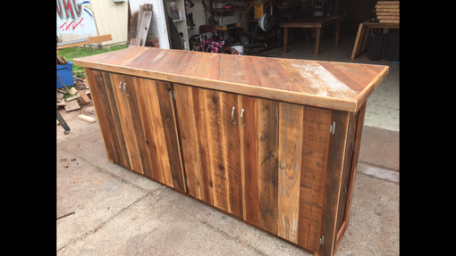 Custom Made Reclaimed Wood Bar With Footrail And Doors