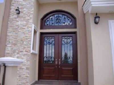 Hand Crafted 6 X 8 Alder Entry Doors With Wrought Iron And An