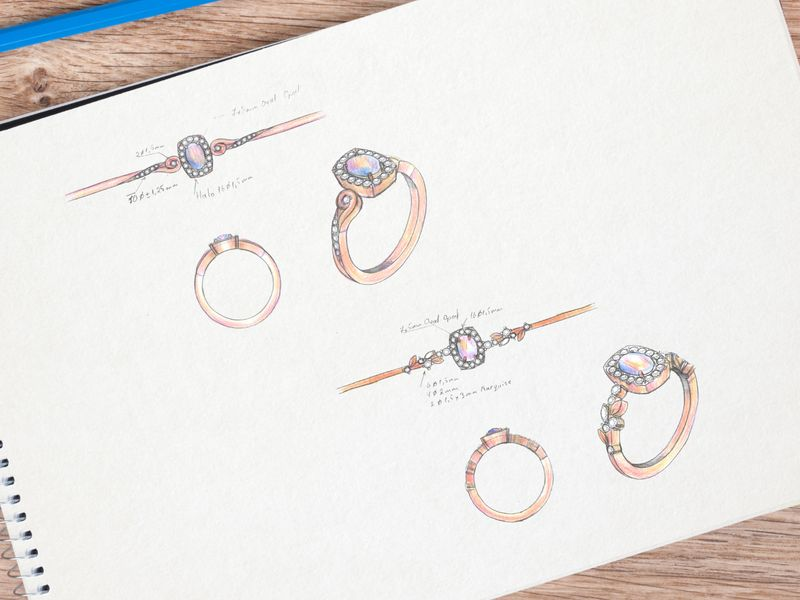 Design sketches our artists created for a rose gold halo ring, featuring an opal center stone.