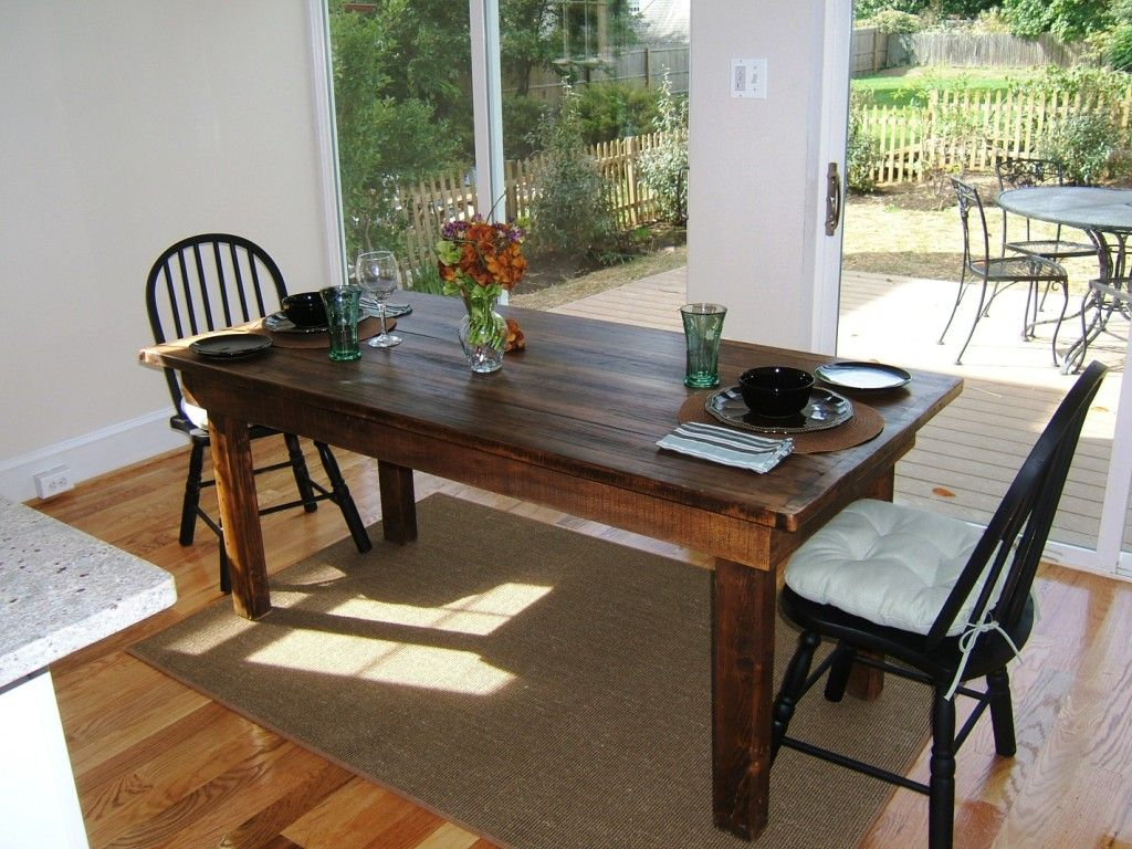 Custom made reclaimed wood farm table by stable tables