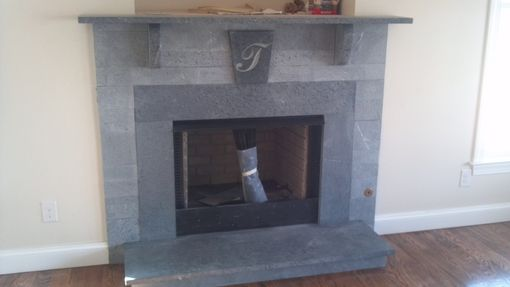 This is a custom made firplace surround created from American soapstone. With a combination of thickness and surface texture