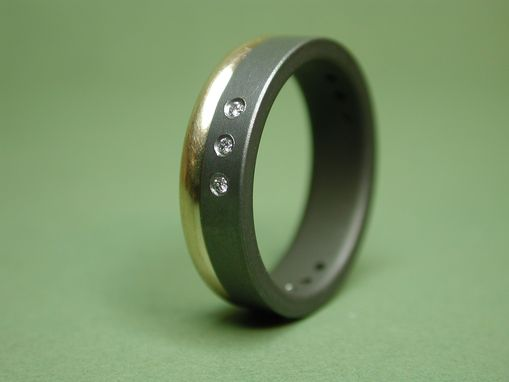 Custom Made Wedding Ring Of Titanium And Diamonds With Attached 14k Yellow Gold Band.