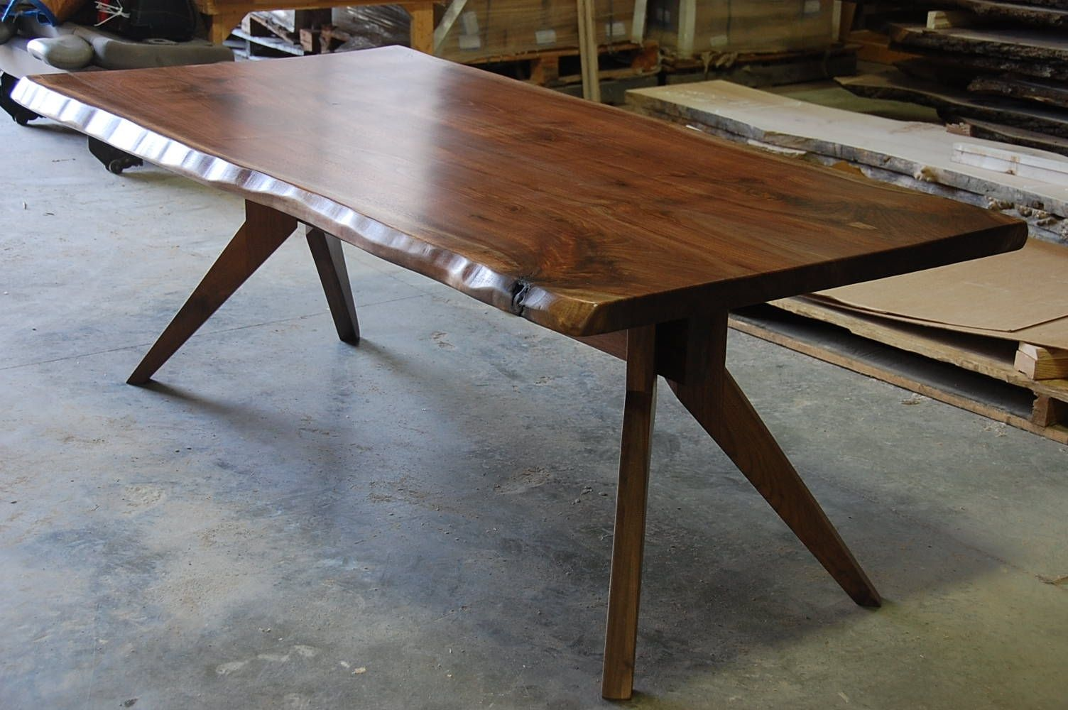 Hand made live edge slab dining table with modern trestle base by corey morgan wood works for Live edge slab dining room table