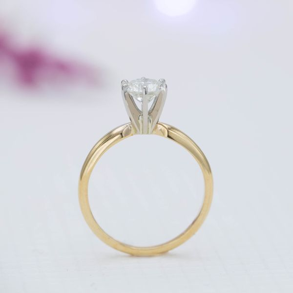 The high, fluted prong setting for this diamond ring is reminiscent of a martini glass.