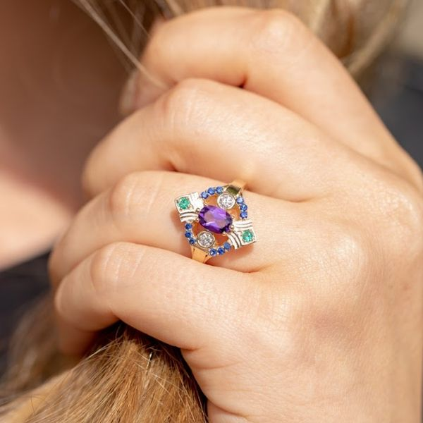 Art Deco-inspired styling with amethyst, sapphire, emerald and diamonds.