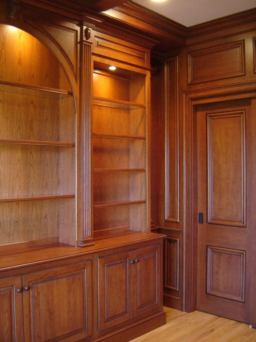 Custom Made Cherry Paneled Library With Bookcases By