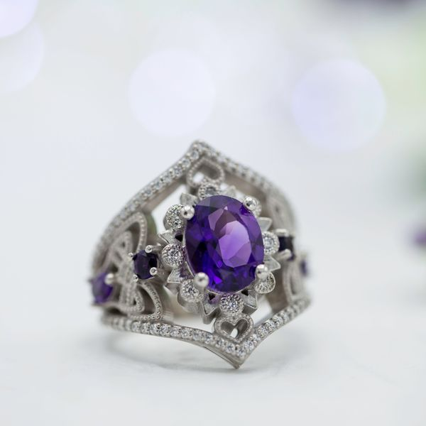 A bold, vintage-inspired engagement ring we designed with an amethyst center stone and tons of CanadaMark diamonds adding sparkle.