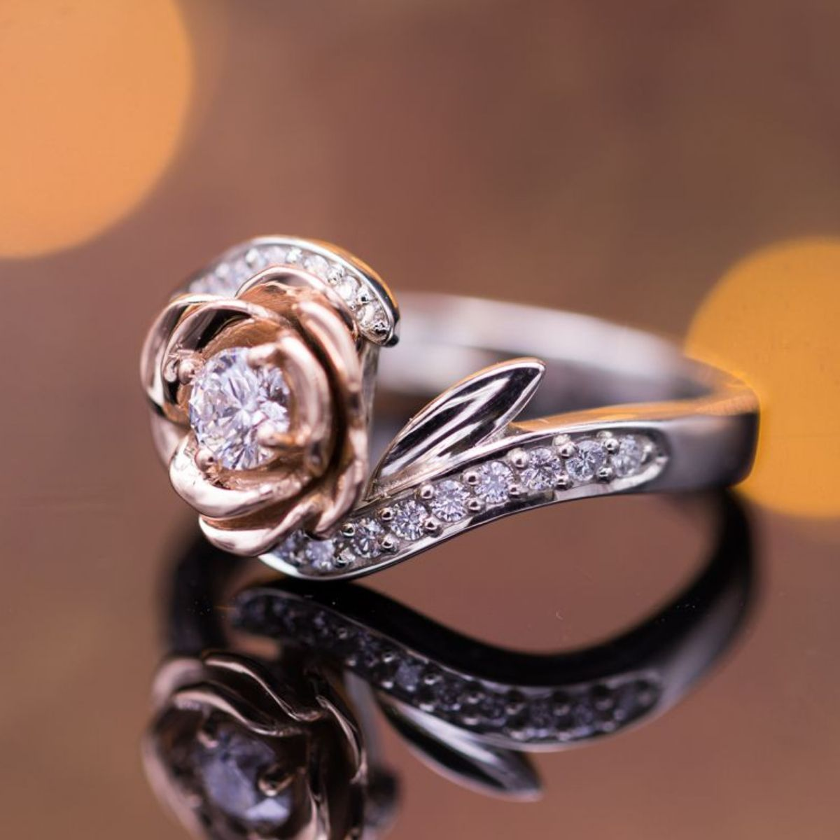 63cb538d06de A blend of rose and white gold in this elegant rose ring with diamonds.
