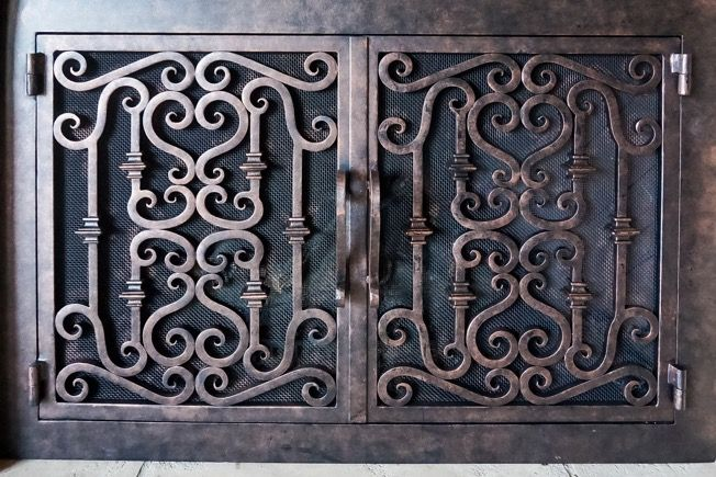 Handmade custom made wrought iron fireplace doors by for Custom wrought iron fireplace screens