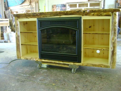 Custom Made Aspen Log Tv Stand With A Built In Electric Fire Place