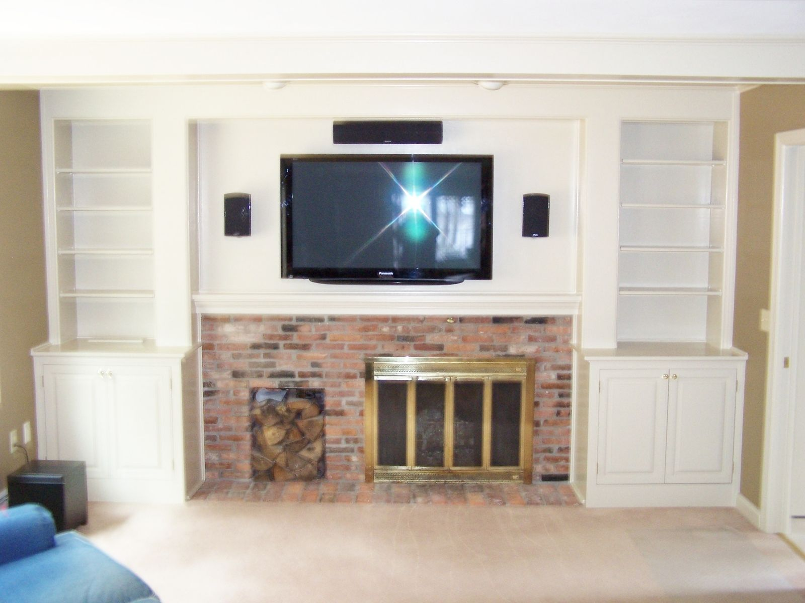 Custom built to fit around the existing fireplace. The electronic components were installed in the RH cabinet with an oak vent on the top. The shelves…
