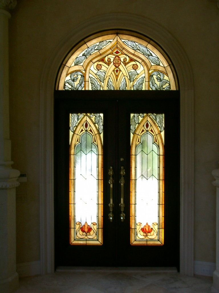 Handmade stained glass entry doors and transom in a for Entry doors with glass