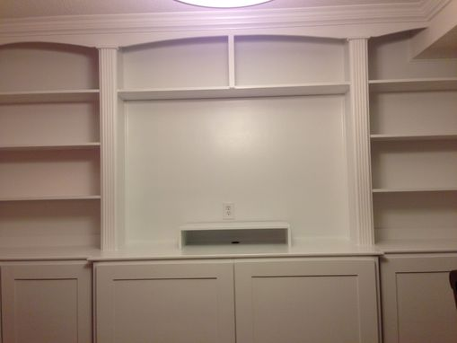 Custom Made Custom  Wall Unit  Centered Around Tv.