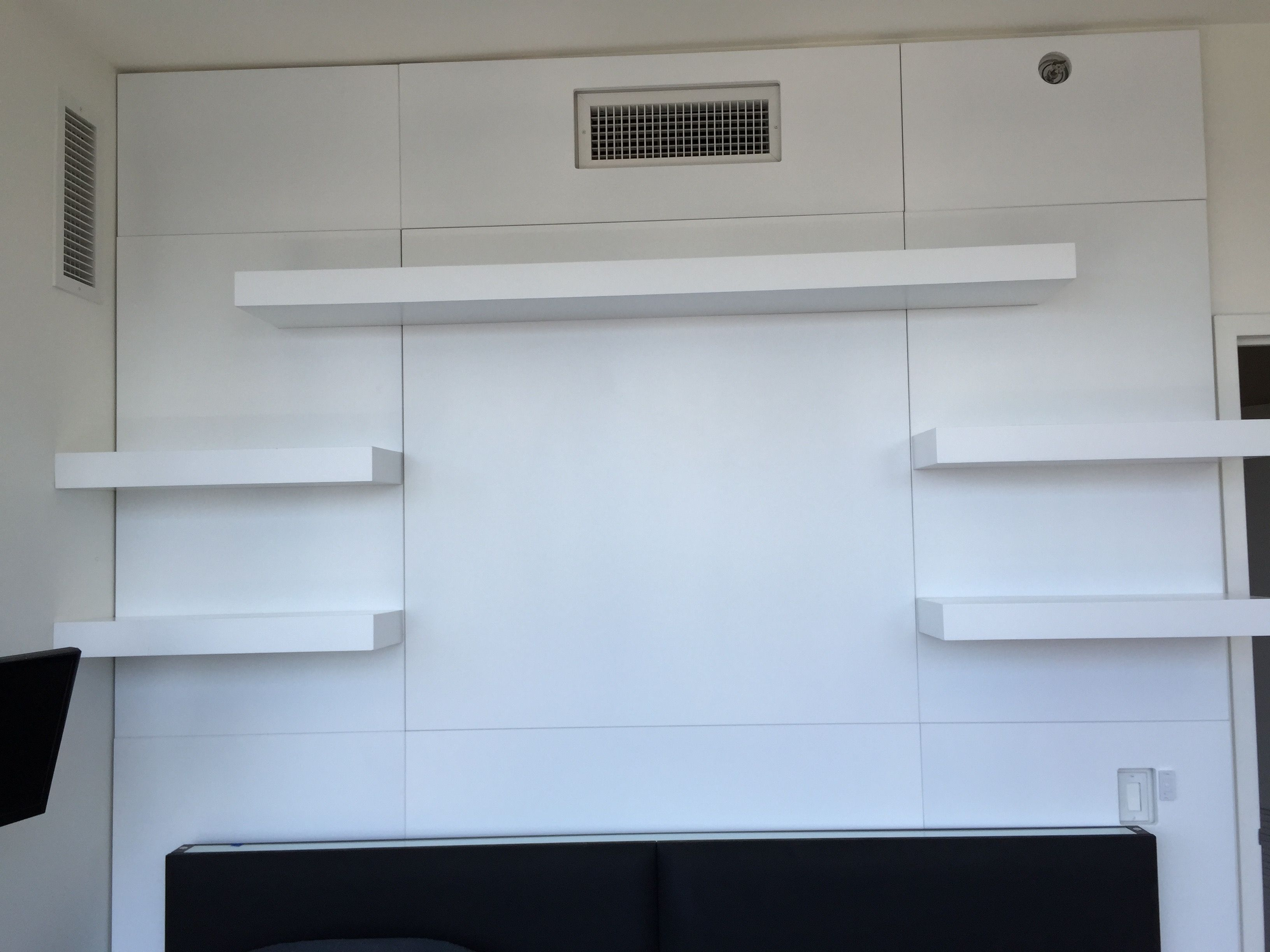 Hand Crafted Wall Unit With Custom Paneling And Floating